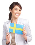 Pretty female holding a swedish flag over white Stock Images