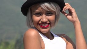 Woman Wearing Red Lipstick. A pretty female latina teen stock images