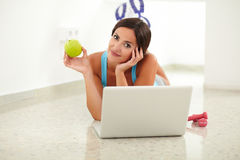 Pretty female laying and browsing on her laptop Stock Photos