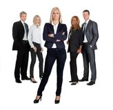 Pretty female leader with her colleagues Stock Images