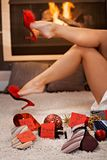 Pretty female legs and christmas gifts Royalty Free Stock Photography