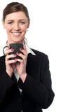 Pretty female manager enjoying her coffee Stock Photos