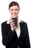 Pretty female manager enjoying her coffee Royalty Free Stock Images