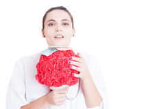 Pretty female medic with paper flower bouquet Stock Photos