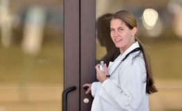 Pretty female medical professional outside office Stock Photo