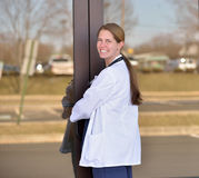 Pretty female medical professional outside office Royalty Free Stock Photo