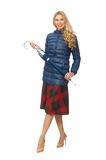 Pretty female model in blue jacket isolated on the Stock Photography