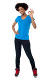 Pretty female model gesturing perfect sign Stock Photography