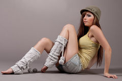 Pretty female model sitting and woolen leggings royalty free stock image