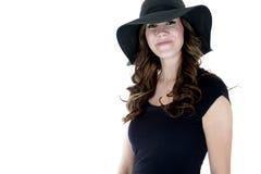 Pretty female model wearing black sun hat Royalty Free Stock Photography