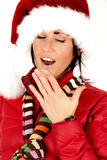 Pretty female model wearing santa hat tired yawning Stock Photo