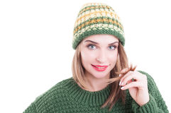 Pretty female model wearing winter knitted had and sweater Royalty Free Stock Images