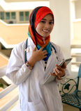 Pretty female Muslim doctor with stethoscope. Stock Image
