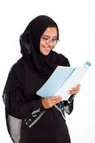 Muslim woman reading Royalty Free Stock Image