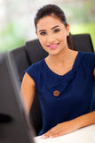 Female office worker. Pretty female office worker by her work station Royalty Free Stock Images
