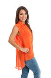 Pretty female in orange top isolated Stock Images