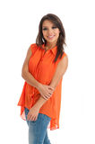 Pretty female in orange top isolated Stock Photo