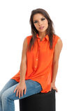 Pretty female in orange top isolated Stock Image
