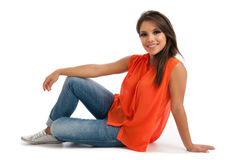 Pretty female in orange top isolated Royalty Free Stock Photography