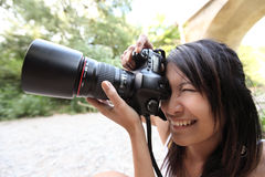 Pretty female photographer Stock Photos