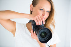 Pretty, female photographer with digital camera Royalty Free Stock Images