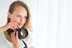 Pretty, female photographer with digital camera Stock Images