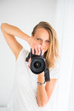 Pretty, female photographer with digital camera Royalty Free Stock Photography