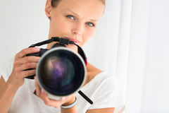Pretty, female photographer with digital camera Royalty Free Stock Photo