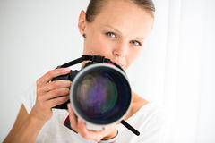 Pretty, female photographer with digital camera Stock Photography