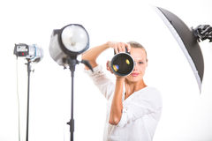 Pretty, female photographer with digital camera Royalty Free Stock Image