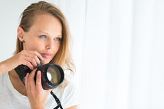 Pretty, female photographer with digital camera Stock Photos