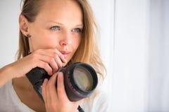 Pretty, female photographer with digital camera Royalty Free Stock Photo