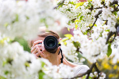 Pretty female photographer outdoors on a lovely spring day Royalty Free Stock Photos