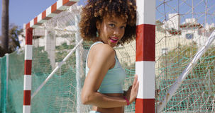 Pretty female posing on playground Royalty Free Stock Photos