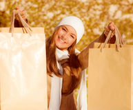 Pretty female with purchase Royalty Free Stock Photos