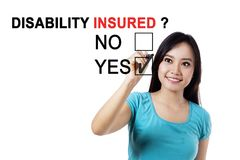 Pretty female with question of disability insured Royalty Free Stock Images