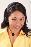 Pretty female receptionist using headset telephone Stock Images