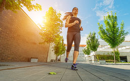 Pretty female runner in the outdoors Stock Photo