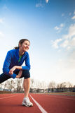 Pretty female runner stretching before her run Royalty Free Stock Photography