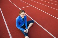 Pretty female runner stretching before her run Royalty Free Stock Photo