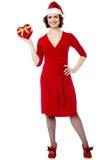 Pretty female santa with xmas gift Stock Image