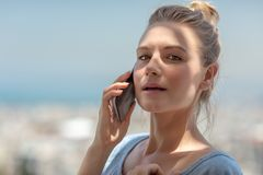 Pretty female speaking on the phone royalty free stock photography