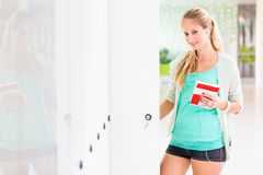 Pretty, female student with books Royalty Free Stock Photo