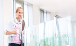 Pretty, female student with books Stock Images