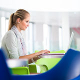 Pretty, female student with books and laptop Royalty Free Stock Photo