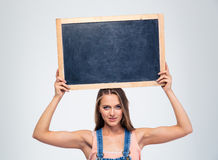 Pretty female student holding blank board Stock Images