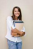 Pretty female student holding books in her hands Stock Photography
