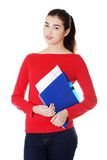 Pretty female student holding her notes Royalty Free Stock Image