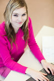 Pretty, female student with laptop Royalty Free Stock Images