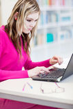 Pretty, female student with laptop and books Royalty Free Stock Photo